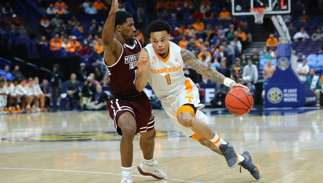 Mar 9, 2018; St. Louis, MO, USA; Tennessee Volunteers guard Lamonte Turner (1) drives against Mississippi State Bulldogs guard Nick Weatherspoon (0) during the first half of the quarterfinals in the SEC Conference Tournament at Scottrade Center. Mandatory Credit: Billy Hurst-USA TODAY Sports