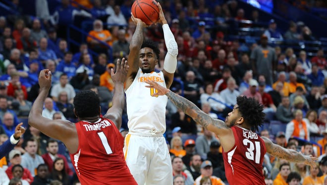 Mar 10, 2018; St. Louis, MO, USA; Tennessee Volunteers guard Jordan Bone (0) puts up a three point shot over the top of Arkansas Razorbacks forward Trey Thompson (1) and guard Anton Beard (31) during the first half of the semifinals of the SEC Conference Tournament at Scottrade Center. Mandatory Credit: Billy Hurst-USA TODAY Sports