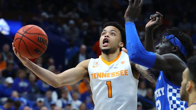 Tennessee guard Lamonte Turner (1) drives to the basket as Kentucky forward Wenyen Gabriel (32) defends during the first half Sunday.