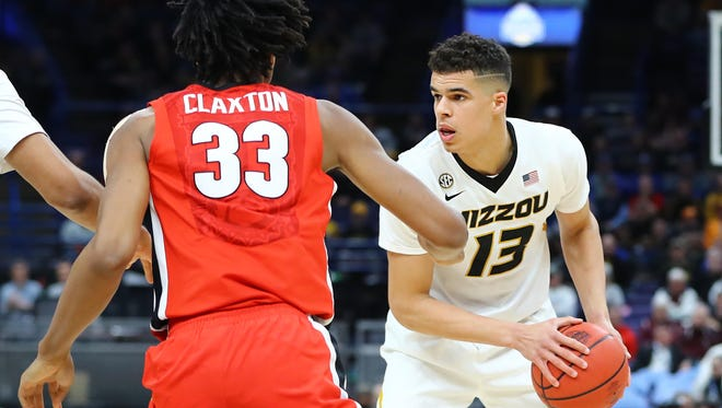 Missouri Tigers forward Michael Porter Jr. (13) handles the ball as he is defended by Georgia Bulldogs forward Nicolas Claxton (33) during the second half of the second round of the SEC Conference Tournament at Scottrade Center. Georgia won 62-60 on March 8, 2018.