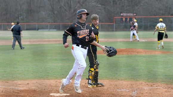 Rosman hosted Murphy on Friday, March 16, 2018. The Bulldogs defeated the Tigers 18-3 in five innings.