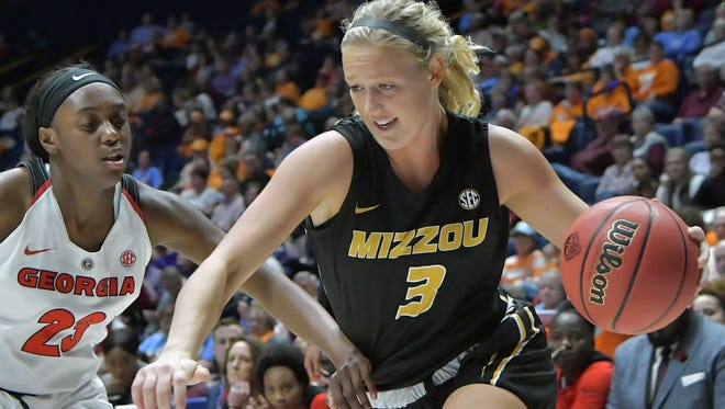 Missouri Tigers guard Sophie Cunningham (3) drives against Georgia Bulldogs guard Que Morrison (23) during the first half of game ten at Bridgestone Arena on March 2 in Nashville.
