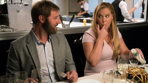 Rory Scovel, left, and Amy Schumer in a scene from