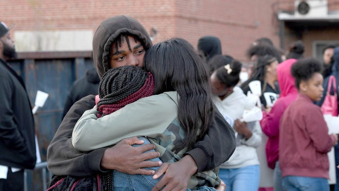 Damion Smith, 15, and Asheville High School student, comforts two girls after a vigil for Harmony Smith and Keithan Whitmire during a meeting of My Daddy Taught Me That and My Sistah Taught Me That on Thursday, April 19, 2018. The siblings were shot and killed by their mother's boyfriend in West Asheville Wednesday night.