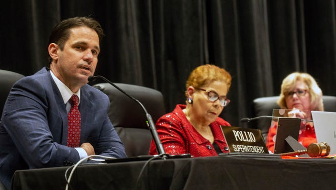 Superintendent Marty Pollio (left) at  JCPS board meeting in April 2018.