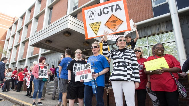 Teachers, parents and students rallied on the steps of the Van Hoose Education Center on Thursday afternoon in a show of unified support for school superintendent Marty Pollio as Frankfort threatens to seize control of JCPS. 4/26/18