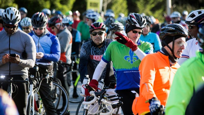 Riders of all experience level prepare to cycle the scenic routes of the Kentucky Derby Festival's Tour de Lou on Sunday morning. 4/29/18