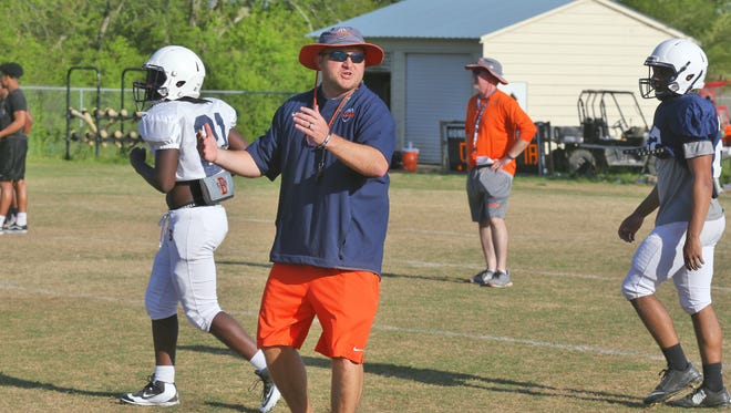 First-year Blackman head football coach Kit Hartsfield instructs players during the team's first day of spring practice Monday.