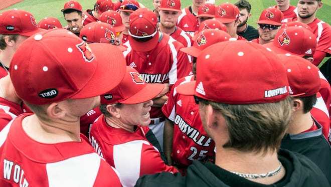 Louisville baseball coach Dan McDonnell has one last pregame pep talk in the outfield at Jim Patterson Stadium. 4/22/18