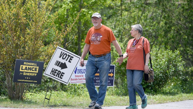 Dan and Gloria Pincu leave Precinct 60.4, Abiding Savior Lutheran Church, in Fairview after voting in the primary election on Tuesday, May 8, 2018.