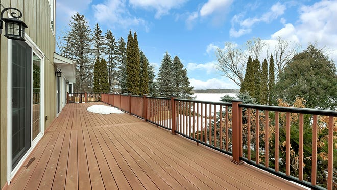 This five-bedroom offers spectacular views of the waterfront landscape and the mature trees that surround the property.
