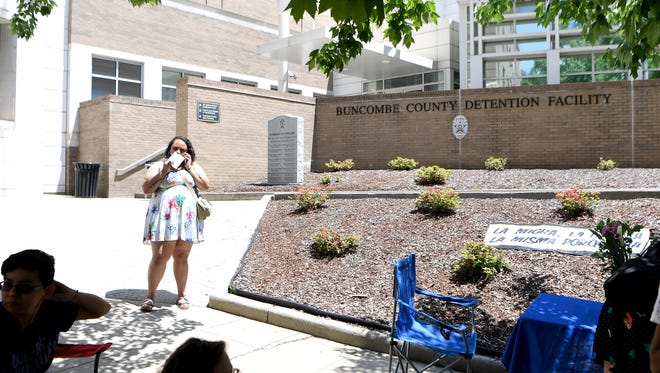 Nicole Townsend, with Southerners on New Ground, talks on the phone outside of the Buncombe County Detention Center as she facilitates the Black Mamas Bailout on Friday, May 11, 2018. Black women were bailed out of the jail so they could spend Mother's Day at home as a protest the cash bail system.