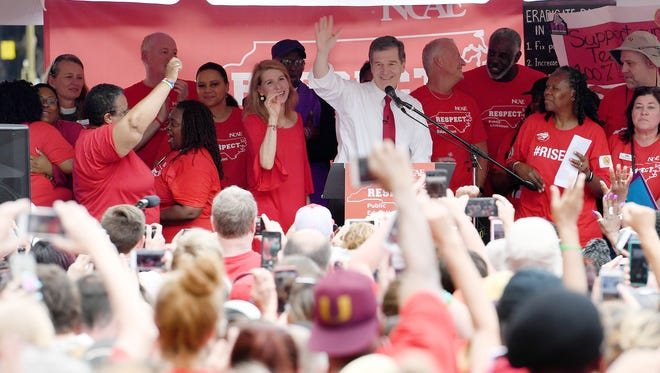 North Carolina Gov. Roy Cooper addresses the crowd as he takes the stage during the March for Students, Rally for Respect in Raleigh on Wednesday, May 16, 2018, a teachers' rally. Cooper's call for students to return to the classroom during the COVID-19 pandemic has caused some tension between himself and schoolteachers, writes Gary Pearce.