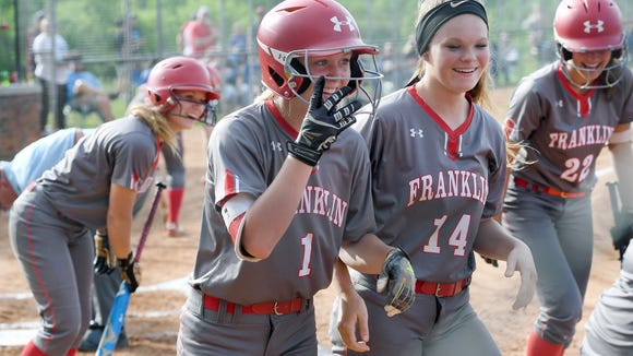 Franklin's Mackenzie Redoutey celebrates with teammate Hailey Freeman after hitting an over-the-fence home-run in the fourth round of the NCHSAA State Championship playoffs against Foard at Macon Middle School on Friday, May 18, 2018. The Lady Panthers defeated the Tigers 4-3 and will advance to face Bunker Hill in the regional round.