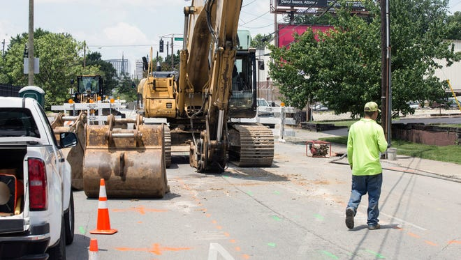 A stretch of Liberty Street between Baxter Avenue and Chestnut Street was blocked off as crews worked on Saturday to repair a sinkhole. 6/2/18