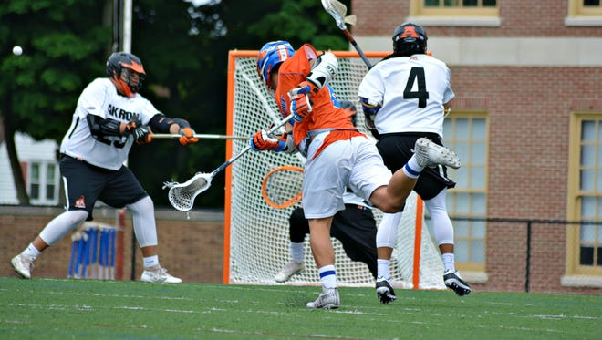 Conner Fingar (8) of Penn Yan shoots for the goal. Penn Yan's 12-11 overtime victory over Akron sent the Mustangs to the state semifinals.