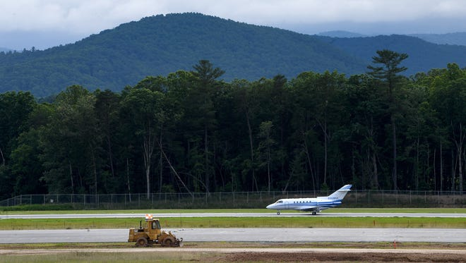 Construction of a new runway at Asheville Regional Airport has encountered delays, but the project should wrap up in December 2020.