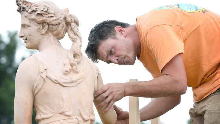 Surgery at Biltmore: A 120-year-old statue gets a new arm