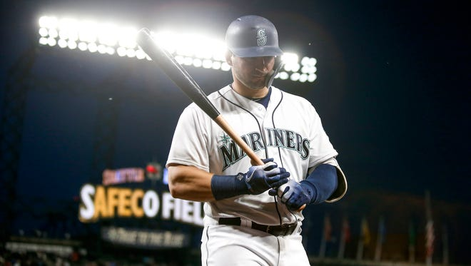 Mariners catcher Mike Zunino returns to the dugout after striking out during a June game against the Boston Red Sox. Zunino struggled during the month of June, hitting just .167 with a .228 on-base percentage and a .375 slugging percentage.