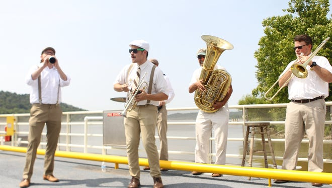 The Cincy River Rats perform on the newly christened ferry between Rising Sun, Indiana, and Rabbit Hash on Thursday, July 12, 2018. The ferry was named the MS Lucky Lady.