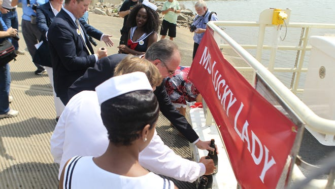 Local politicians and Dan Lee christen the ferry between Rising Sun, Indiana, and Rabbit Hash on Thursday, July 12, 2018. The ferry was named the MS Lucky Lady.