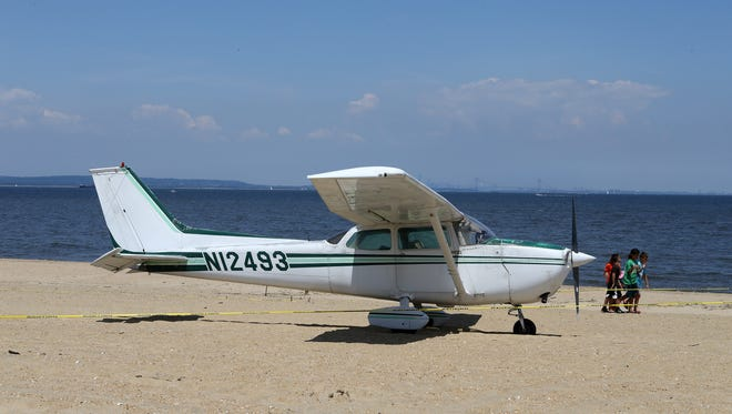 A Cessna plane lands on the beach near Beachway and Oceanview Avenue in Keansburg, NJ Friday July 13, 2018.