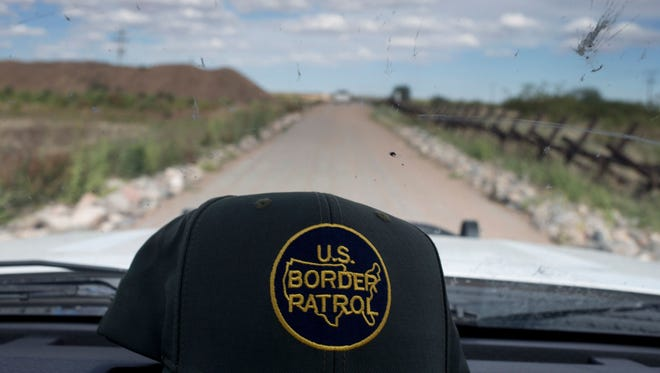 A former U.S. border patrol agent was sentenced to 20 months in prison Tuesday, after pleading guilty to agreeing to smugglemarijuana into the United States from Mexico, officials said.