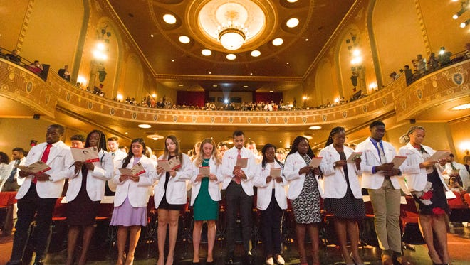 The Rutgers Robert Wood Johnson Medical School Class of 2022 recites the Hippocratic Oath at the end of the White Coat Ceremony as an official act of the start of their journey in medicine.