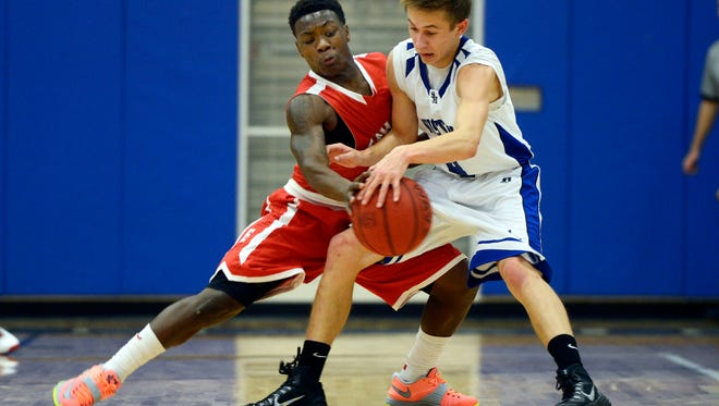 Erwin's Keyal Talbert attempts to steal the ball from Smoky Mountain's Bret Baldwin on Tuesday in Sylva.