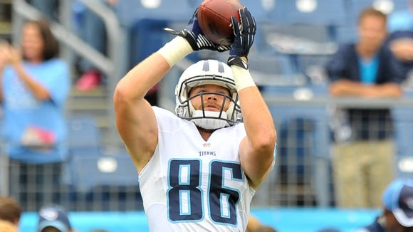 Titans tight end Chase Coffman catches a pass before Tennessee's game against Jacksonville in Oct. 12.