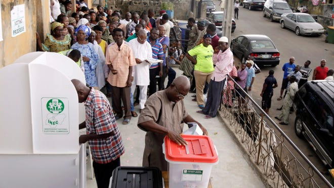 A man casts his ballot as Nigerians vote for a second day in Lagos, Nigeria, on Sunday March 29, 2015. Technical problems and extremist violence have interfered.