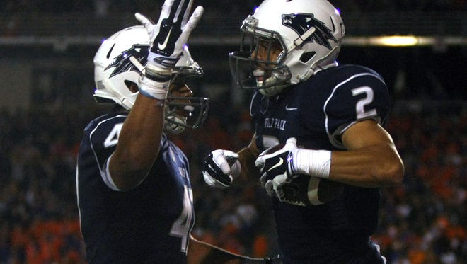 Oct 4, 2014; Reno, NV, USA; Nevada Wolf Pack tight end Jarred Gipson (47) celebrates with wide receiver Richy Turner (2) after a two point conversion pass in the third quarter against the Boise State Broncos at MacKay Stadium. Mandatory Credit: Lance Iversen-USA TODAY Sports. Boise State won 51-46.