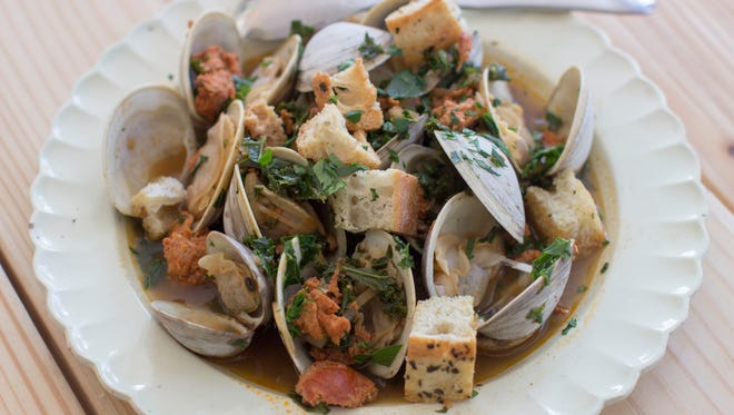 """Spicy clam and kale soup in Concord, N.H. Tucked away between the tofu """"cheeses"""" and textured vegetable protein taco crumbles lies a good go-to and good-for-you ingredient, soy chorizo."""