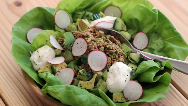 "Edamame and walnut lettuce wraps in Concord, N.H. on March 9, 2015. This recipe pairs firm edamame with crunchy walnuts and some spices to make a cold vegetarian ""meat"" for lettuce wraps or tacos."