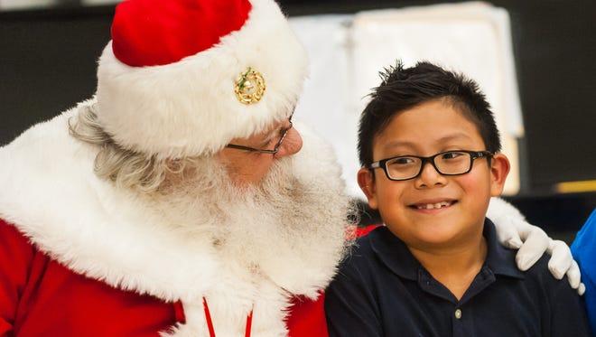 Caser Ramos meets with Santa at Somerdale Park School.