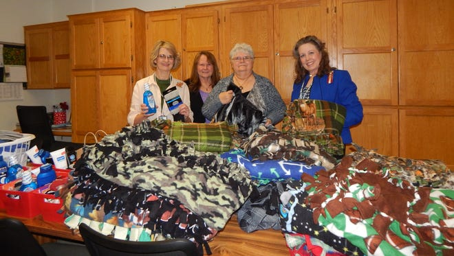Shawneetown Chapter 2706 of United Daughters of the Confederacy delivered 22 lap blankets, toiletries and magazines for Veterans at the VA in Fayetteville. Members visited with veterans and enjoyed hearing their stories and seeing their emotion at receiving the items. Pictured from left are Carol Kick, head of Donation Department at the VA; Kathleen Huff, Shawneetown #2706 member; Virginia Griffin, Shawneetown #2706 president; and Kay Tatum, Arkansas Daughters of the Confederacy division president. Anyone interested in joining the Daughters of the Confederacy is welcome to attend our meetings held the first Monday of each month at the Main St Church of Christ in Yellville at 6 p.m.