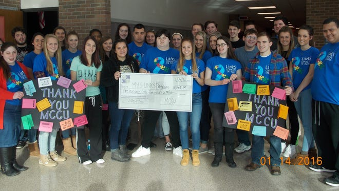 A total of $145 was donated to the Marshall High School LINKS program through a fundraiser by the school's student-operated Marshall Community Credit Union branch.