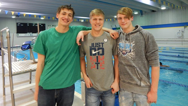 Iowa City West has a trio of college-bound swimmers: from left, Will Scott, Aidan Keen and Mark McGlaughlin.