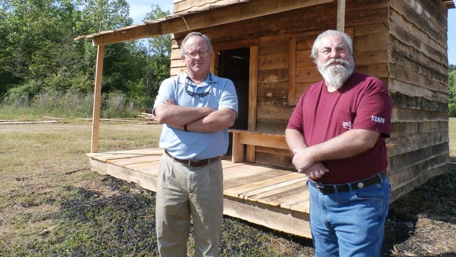 "Ray Hogg, left, and James Hammonds inspect a wood ""house"" that will be burned during the annual Battle of Selma re-enactment this weekend."