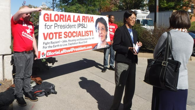 Gloria La Riva, presidential candidate for the Party of Socialism and Liberation, campaigns on the University of Iowa campus Thursday.