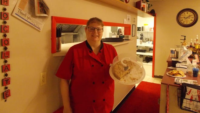 Food Frenzy Cafe owner Candy Klee displays fresh coffee cake in her restaurant at 600 Central Ave.