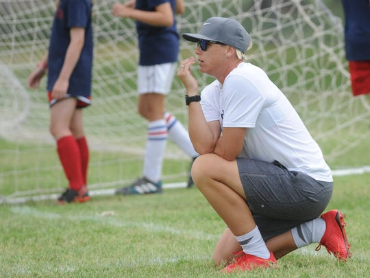 Abby Wambach watches as youngsters participate in a drill during the Full Pitch Soccer Academy on Sunday, June 3, 2018 at Madison Middle School.