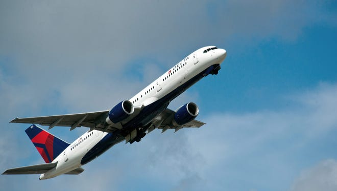 A Delta Airlines jet takes off.