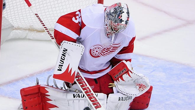 Jimmy Howard makes one of his 19 saves for the Red Wings.
