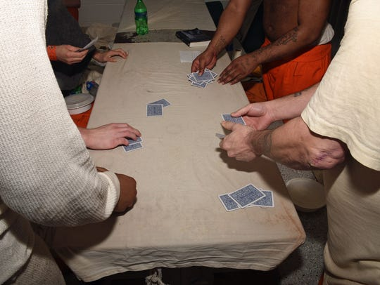 Inmates playing cards inside the Pickens County Detention