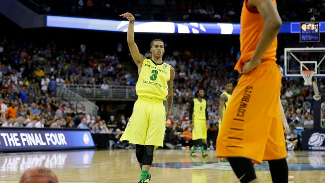 Oregon guard Joseph Young reacts at the end of an NCAA tournament college basketball game against Oklahoma State in the Round of 64, Friday, March 20, 2015, in Omaha, Neb. Young scored 27 points as Oregon won 79-73.