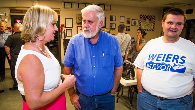 Glendale Mayor Jerry Weiers (middle), speaks with Glendale City Councilwoman Lauren Tolmachoff (left) and James Deibler as primary election results come in.