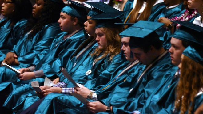 Graduates take part in the Isaac Bear Early College High school graduation at UNCW's Kenan Auditorium in 2019. Over 50 graduates took part in the Commencement.