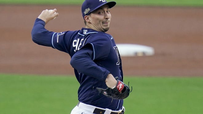 Tampa Bay Rays pitcher Blake Snell delivers against the New York Yankees during the first inning in Game one of a baseball American League Division Series, Monday, Oct. 5, 2020, in San Diego.