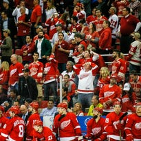 Detroit Red Wings fans and the bench react at the end of Game 4 against the Tampa Bay Lightning after losing 3-2 at Joe Louis Arena in Detroit on Tuesday, April 19, 2016.